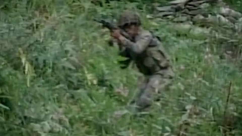 Army personnel conduct a search operation in forest area of Kalaroos in Kupwara,late on Friday night.
