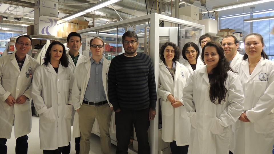 Professor Sachdev Sidhu with his colleagues in his lab at the University of Toronto.