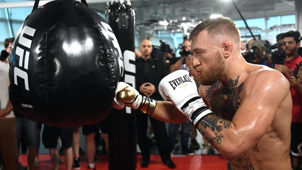 UFC lightweight champion Conor McGregor hits an uppercut bag during a media workout at the UFC Performance Institute on Friday in Las Vegas, Nevada. McGregor will fight Floyd Mayweather Jr. in a boxing match at T-Mobile Arena on August 26 in Las Vegas.