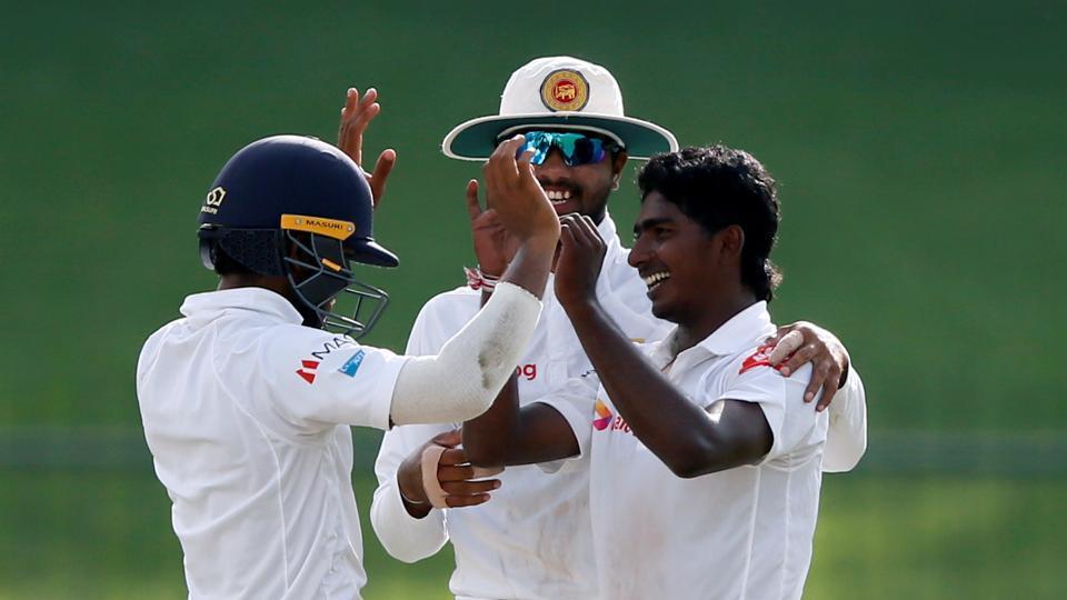 Lakshan Sandakan (R) celebrates with captain Dinesh Chandimal and Kusal Mendis (L) the wicket of Virat Kohli on Day 1 of third and the final Test between India vs Sri Lanka at Pallekele. Catch full cricket score of India vs Sri Lanka, 3rd Test, Day 1 at Pallekele here