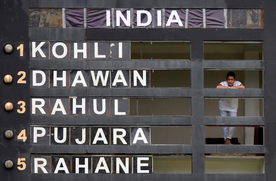 A man watches the match from inside the score board building in Pallekele. (REUTERS)