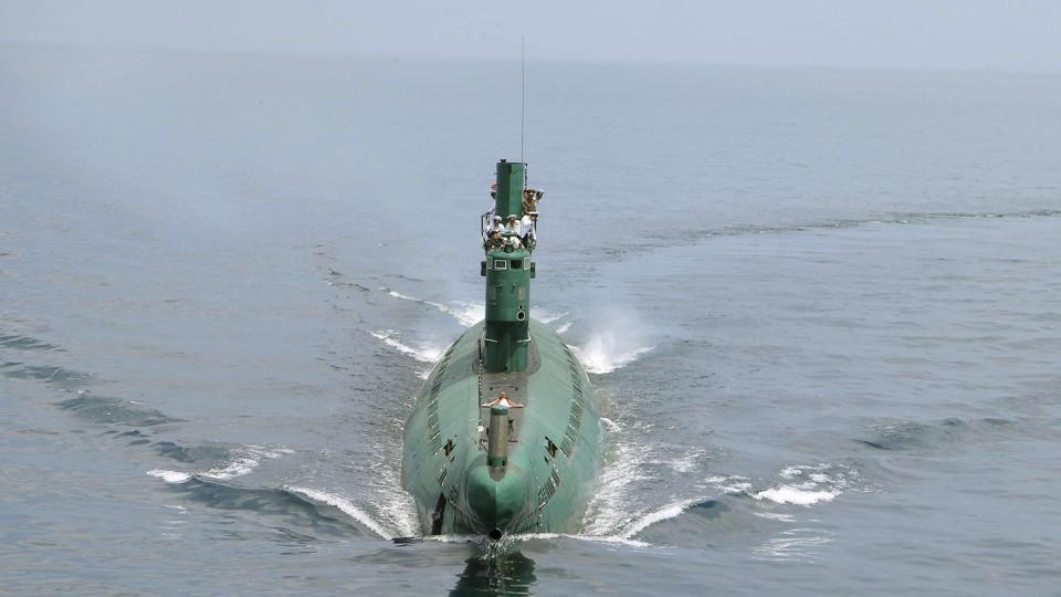 North Korean leader Kim Jong Un (front) stands on the conning tower of a submarine during his inspection of the Korean People's Army (KPA) Naval Unit 167 in this undated photo released by North Korea's Korean Central News Agency (KCNA) in Pyongyang June 16, 2014.