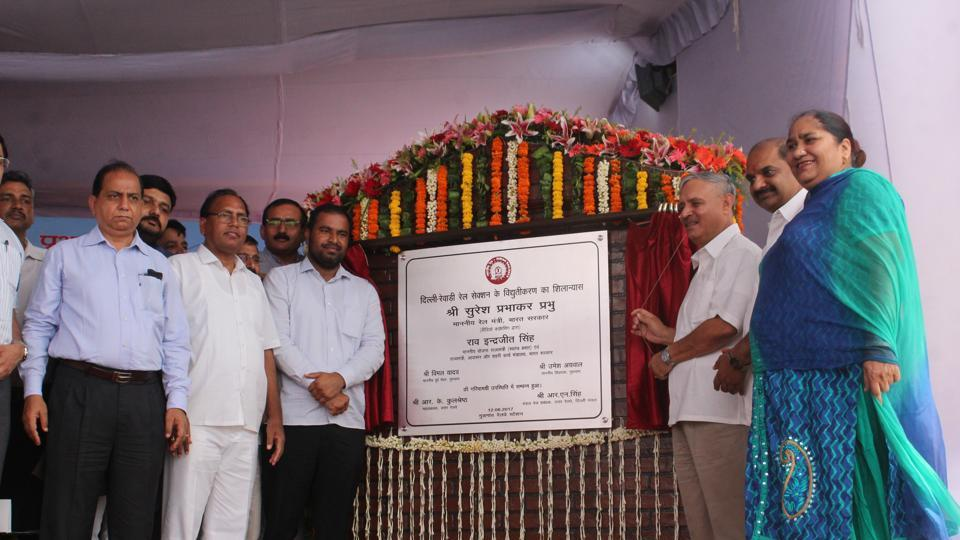 Union Minister of state for planning Rao Inderjit Singh (third from right) unveils the foundation stone of the rail electrification project at Gurgaon railway station onSaturday.