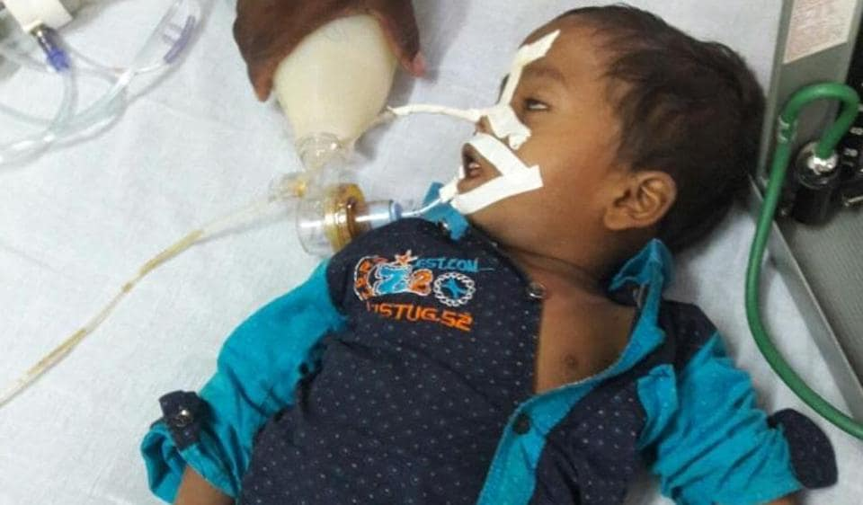 A child at the BRD Medical college in Gorakhpur where 30 children  have died allegedly due to shortage of oxygen .