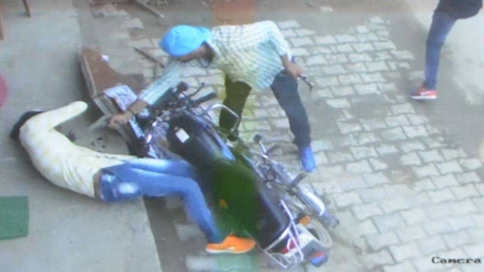 A CCTV grab where the assailant is seen firing at the undertrial from a close range in Rohtak on Friday.