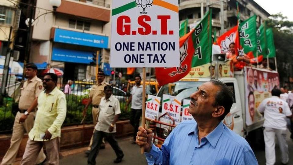 A supporter of the Bharatiya Janata Party holds a placard during a rally to support implementation of the Goods and Services Tax (GST) in Mumbai.