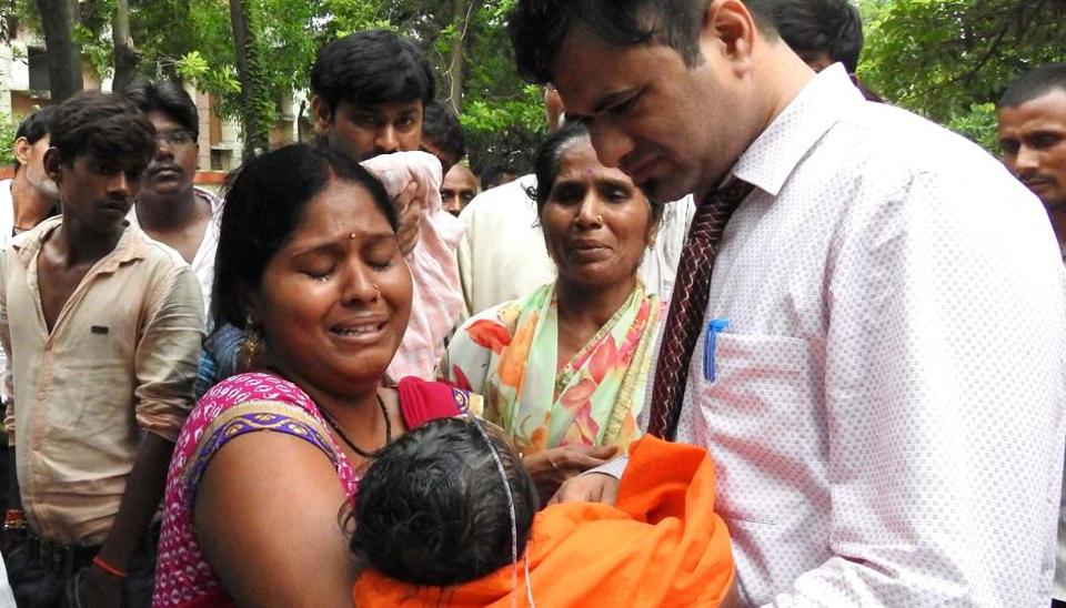 Relatives mourn the death of a child at the Baba Raghav Das Hospital in Gorakhpur on August 12, 2017.