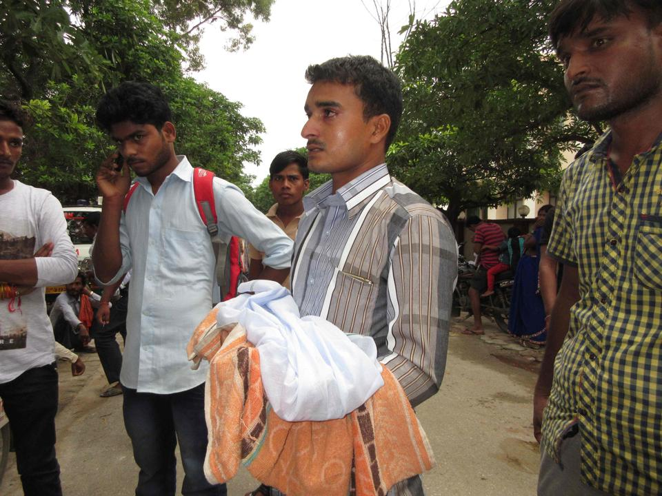A relative mourns the death of a children outside Baba Raghav Das Hospital in Gorakhpur district on Friday. More than 30 children have died at a government-run hospital in Uttar Pradesh over 48 hours, police said on August 11, allegedly due to lack of oxygen supply to the wards housing the sick.