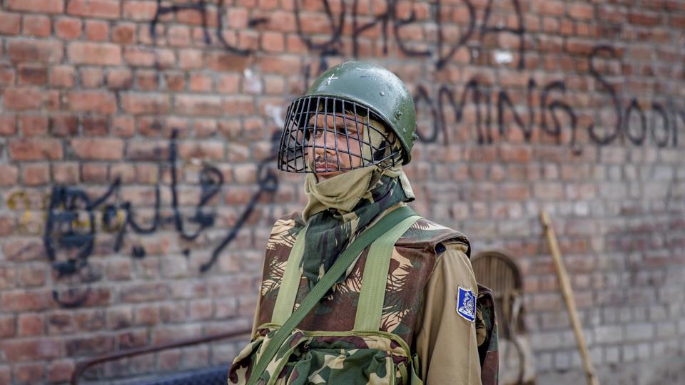 An Indian paramilitary soldier stands guard during curfew in Srinagar, Saturday.