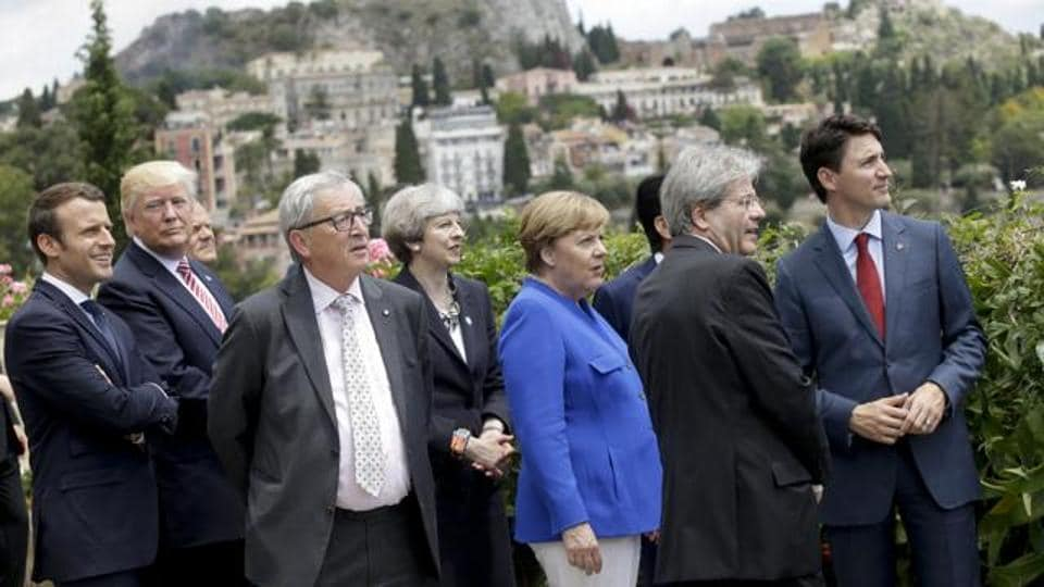 From left, French President Emmanuel Macron, US President Donald Trump, EU Commission President Jean-Claude Juncker, British Prime Minister Theresa May, German Chancellor Angela Merkel, Italian Prime Minister Paolo Gentiloni and Canadian Prime Minister Justin Trudeau, Italy, May 26, 2017