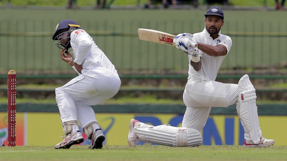 Sri Lanka's Kusal Mendis, left, reacts after a shot played by India's Shikhar Dhawan. (AP)