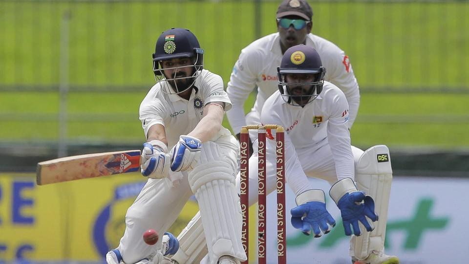 India's Lokesh Rahul, left, plays a shot during the first day's play of their 3rd Test match. (AP)