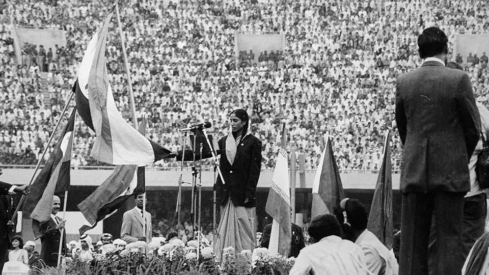 A view of the opening ceremony at the 1982 Asian Games held in New Delhi where Geeta Zutshi takes the athletes' oath. New Delhi became the only other nation joining Bangkok to host multiple iterations of the Asiad on this occasion.