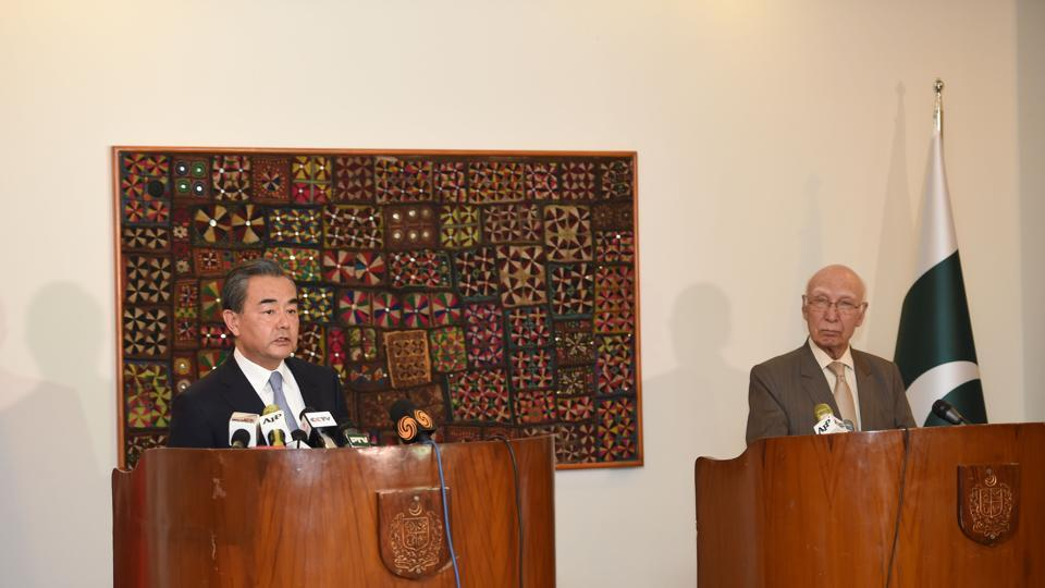Chinese Foreign Minister Wang Yi (L) and Pakistani Advisor to the Prime Minister on National Security and Foreign Affairs Sartaj Aziz attend a press briefing at the Nor Khan Air base in Rawalpindi on June 25, 2017.
