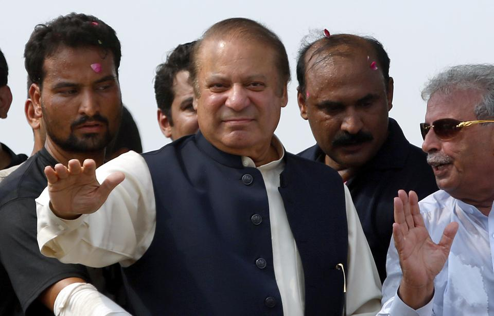Nawaz Sharif waves to supporters during a rally in Muridke on  August 12, 2017.