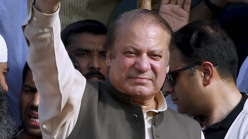 Deposed Pakistani Prime Minister Nawaz Sharif waves to his supporters while he arrives to address a rally in Gujrat, Pakistan on Friday.