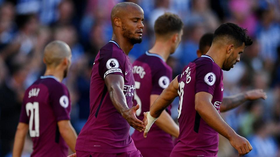 Manchester City's Vincent Kompany and Sergio Aguero celebrate after Brighton's Lewis Dunk scores an own goal. Get full football score from Manchester City vs Brighton, Premier League 2017-18, here.