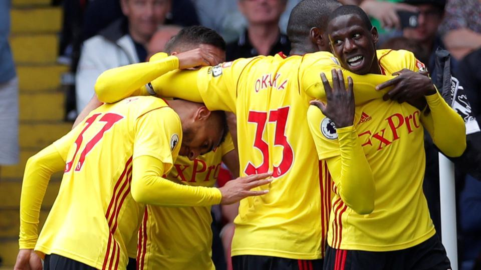 Watford's Abdoulaye Doucoure celebrates scoring their second goal against Liverpool with Stefano Okaka and team mates.