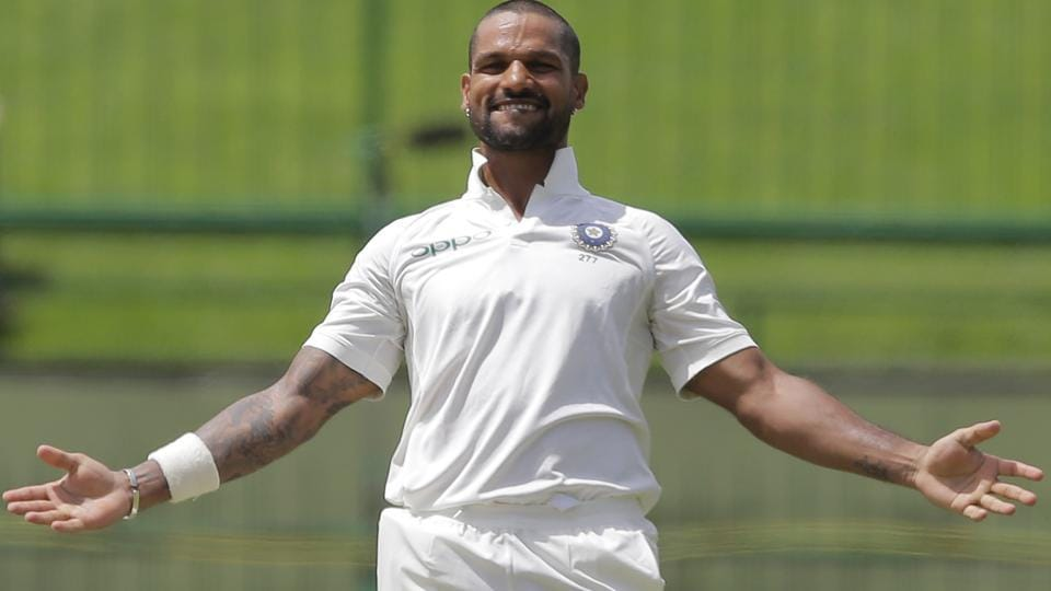 India's Shikhar Dhawan celebrates scoring a century during the first day's play of their third cricket Test match against Sri Lanka. (AP)