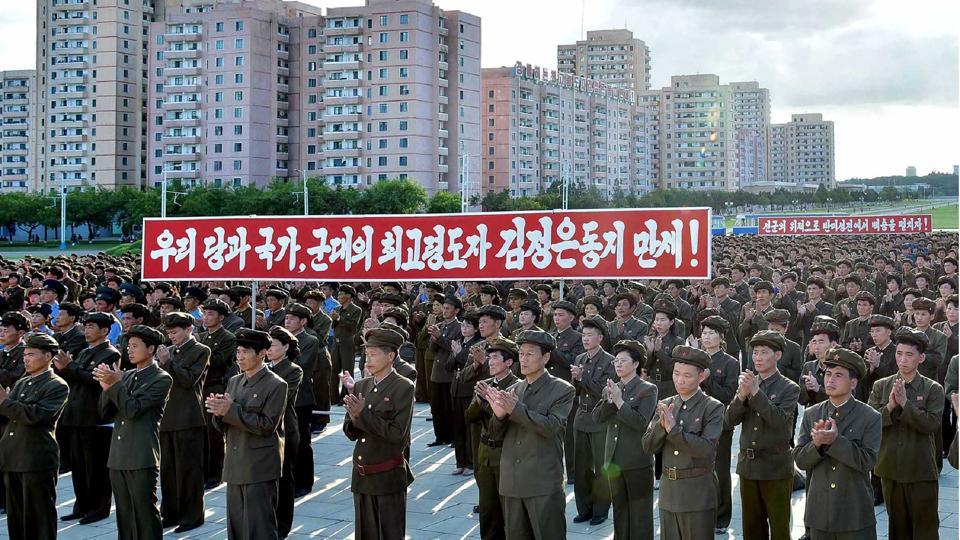 North Korean youngsters, workers and trade union members hold a rally to protest the UN security council's sanctions resolution at the compound of the Monument to Party Founding in Pyongyang on Friday.