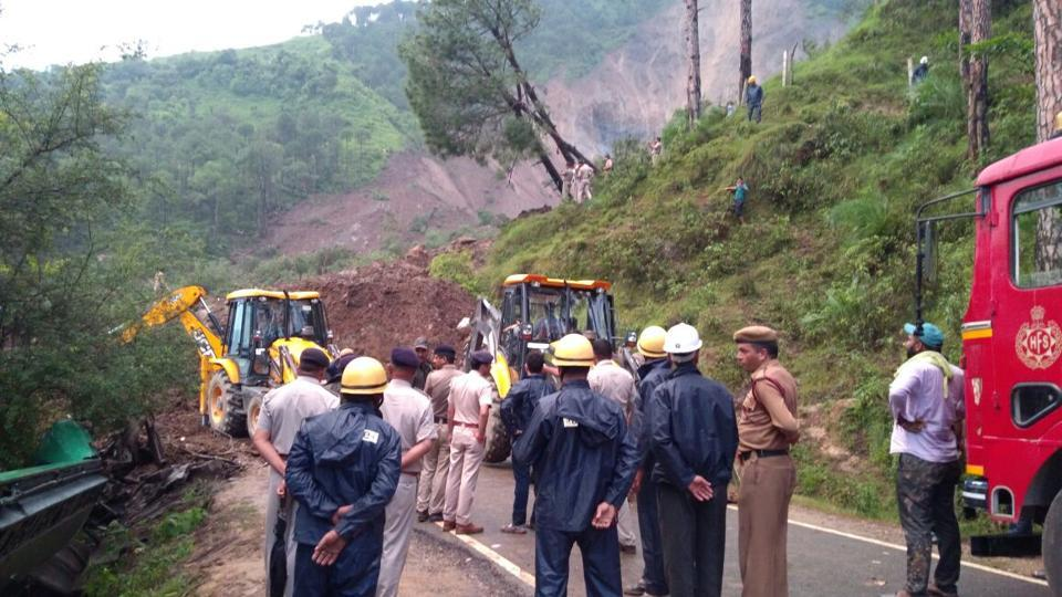 Officials carry out rescue work after a landslide in Himachal Pradesh's Mandi district on Sunday morning. (HT Photo)
