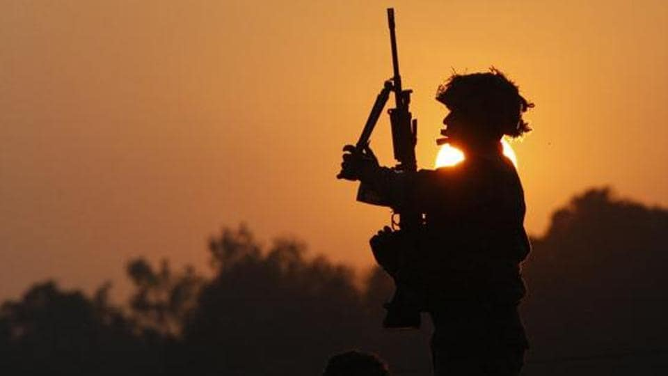 An Indian army soldie stands guard outside the air force base in Pathankot.