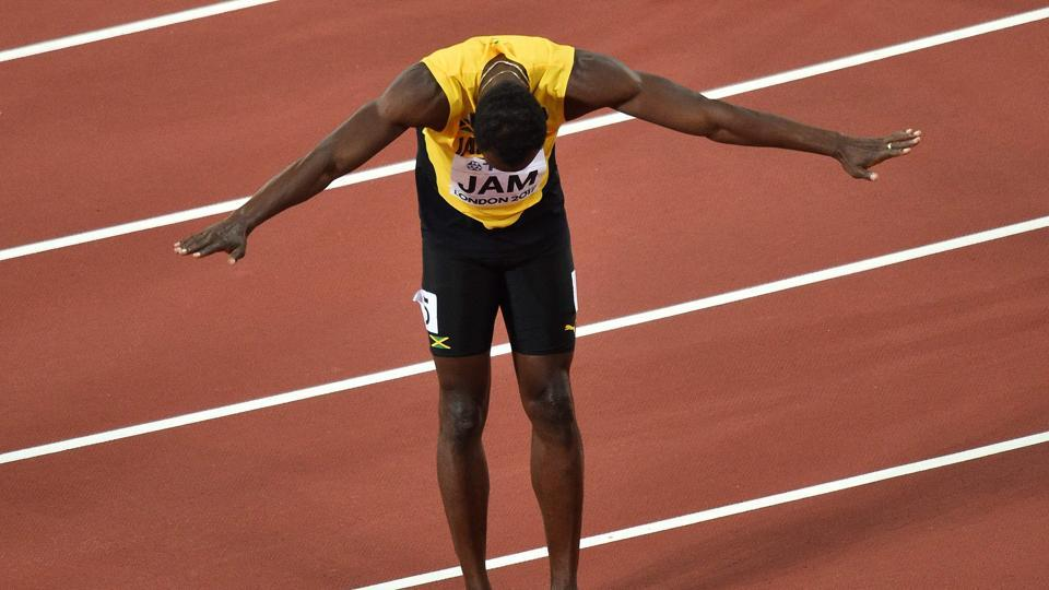 Jamaica's Usain Bolt gestures to the crowd after he pulled up injured in the final of the men's 4x100m relay athletics event at the 2017 IAAF World Championships at the London Stadium on Sunday.