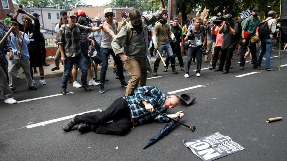 A man is down during a clash between members of white nationalist protesters and a group of counter-protesters in Charlottesville, Virginia,
