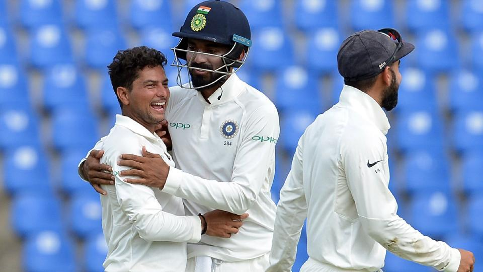 Indian cricketer Kuldeep Yadav (L) celebrates with his teammates after he dismissed Sri Lankan cricketer Dilruwan Perera. (AFP)