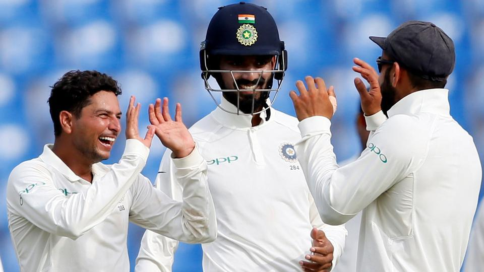 India's Kuldeep Yadav celebrates with captain Virat Kohli and Lokesh Rahul after taking the wicket of Sri Lanka's Vishwa Fernando.