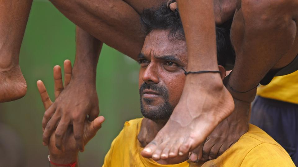 Members test their strength during a practice session. (Pratik Chorge/HT)