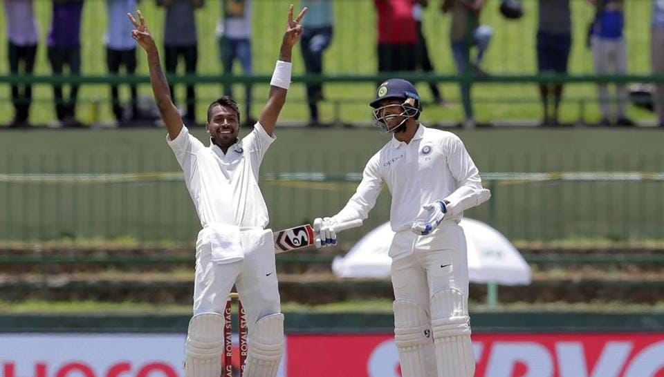 Hardik Pandya (L) gestures towards dressing room as he celebrates his maiden century during the second day's play of the third cricket Test match between India and Sri Lanka at Pallekele.