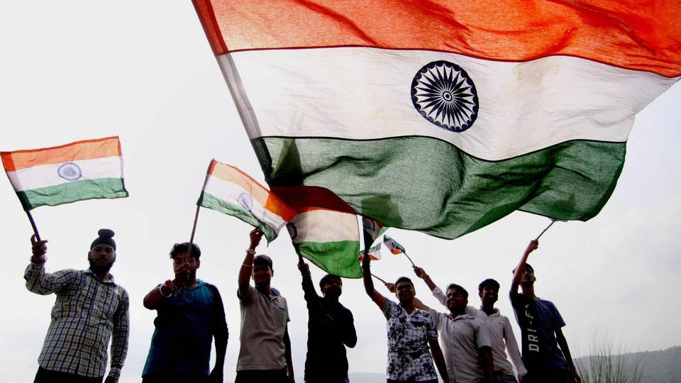Youngsters wave the national flag ahead of India's Independence Day, in Jammu on Saturday.India celebrates its 71st year of Independence this August 15.  (PTI)