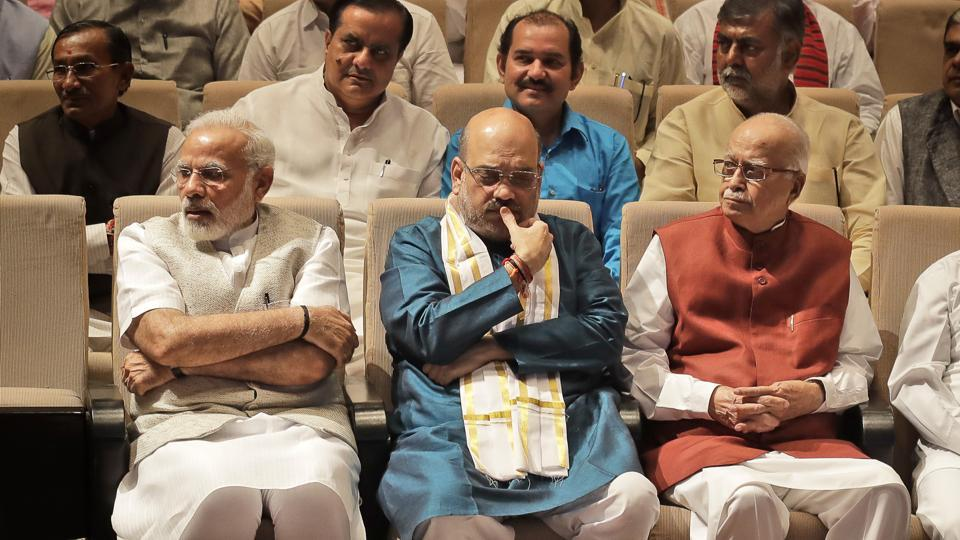 Indian Prime Minister Narendra Modi, left, Bharatiya Janata Party or BJP President Amit Shah, centre, and senior leader L.K.Advani, right, sit during parliamentary party meeting in New Delhi, India, Thursday, Aug. 10, 2017. Shah, who completed three years of party presidentship won the upper house election of the Indian parliament from Gujarat. (Manish Swarup/AP)