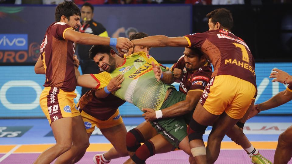 UP Yoddha's players pin down Patna Pirates' Captain Pardeep Narwal, in green jersey, during their Pro Kabaddi League 2017 match.