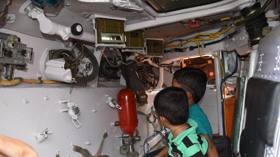 Schoolchildren inspect the interior of one of the vehicles showcased at the 'Know Your Army' exhibition. (HT PHOTO)