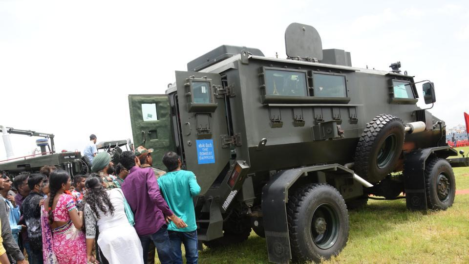 Visitors eagerly looking at the interior of an army combat truck at the  'Know Your Army' exhibition.  (HT PHOTO)