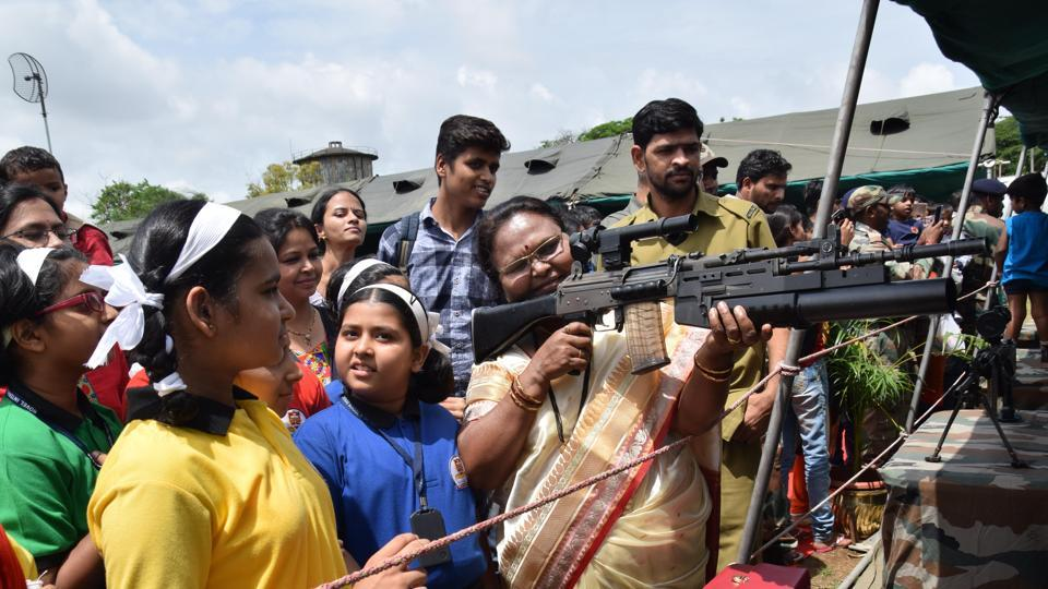 A teacher trying out a rifle at the exhibition. (HT PHOTO)