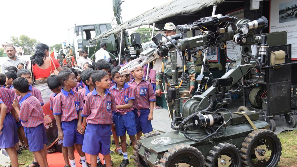 Children try to understand the working of an advanced remote controlled machine at the 'Know Your Army' exhibition.  (HT PHOTO)