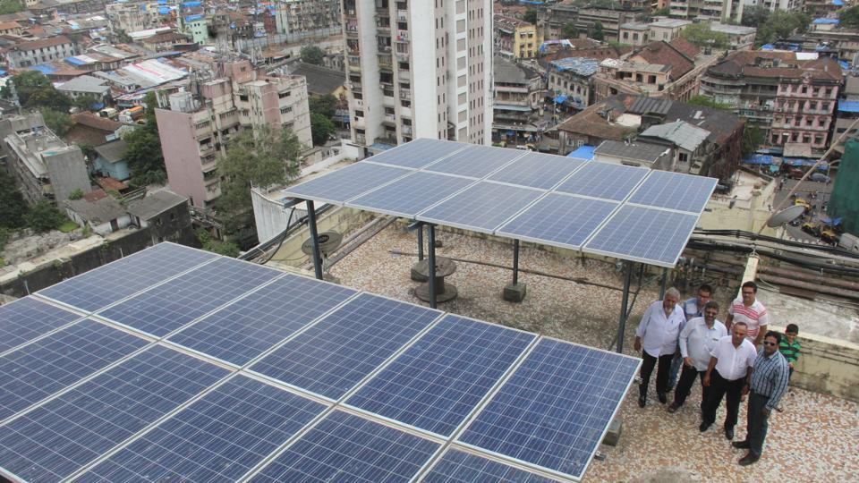 Residents with the solar panels.