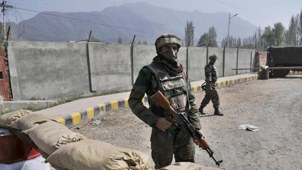 An Army soldier stands guard near a check post outside Badami Bagh cantonment in Srinagar.