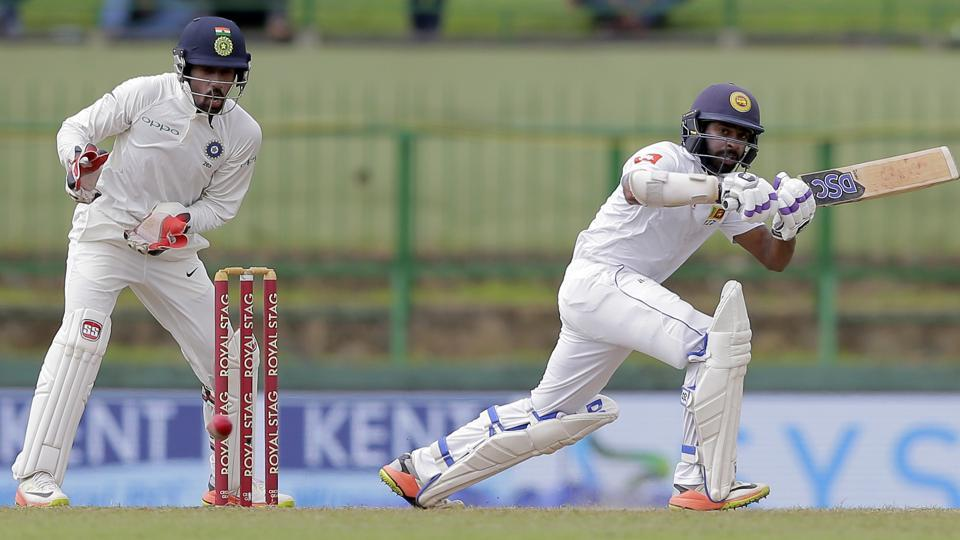 Sri Lanka's Niroshan Dickwella, right, plays a shot during the second day's play of their third cricket test match against India in Pallekele. (AP)