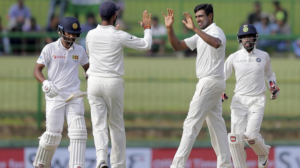 India's Ravichandran Ashwin, second right, celebrates with teammates the dismissal of Sri Lanka's captain Dinesh Chandimal. (AP)
