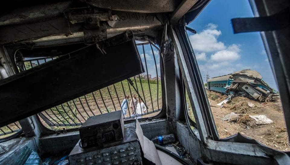 A picture taken on August 12 from the cab of one of the trains in a fatal collision from the day before shows the damage and the wreckage nearby, in the area of Khorshid on the outskirts of Egypt's Mediterranean city of Alexandria.