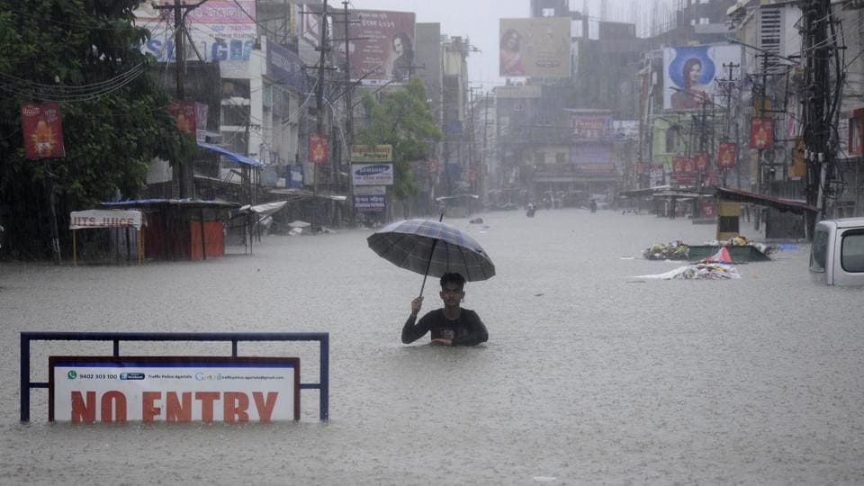 An Indian man wades a flooded street during a heavy downpour in Agartala, the capital of northeastern state of Tripura on August 11, 2017.  (Arindam Dey/AFP)