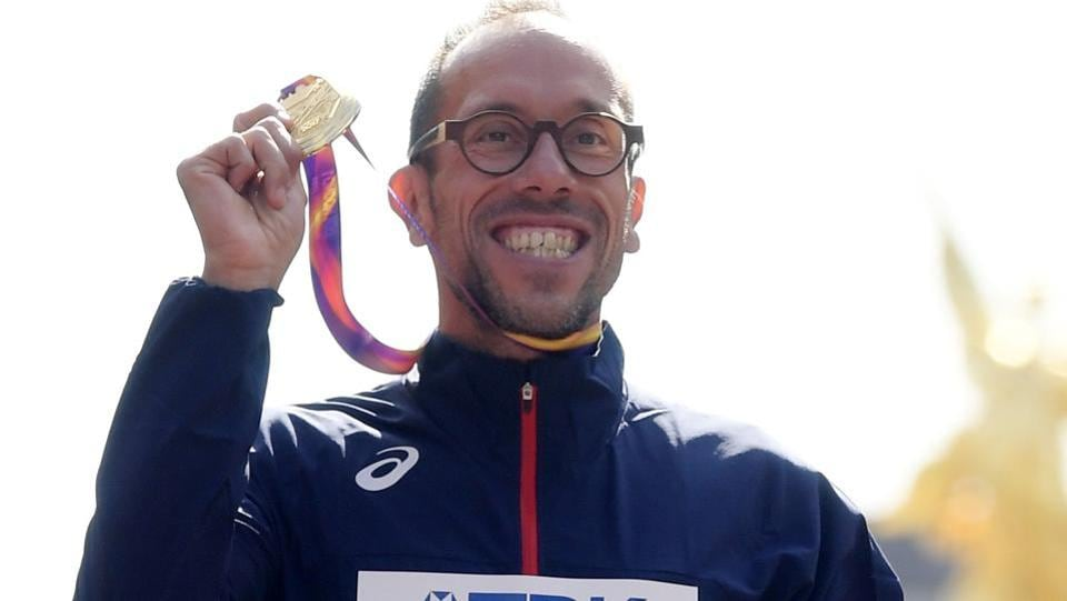 Yohann Diniz (gold) of France poses with the medal at the IAAFWorld Championships.