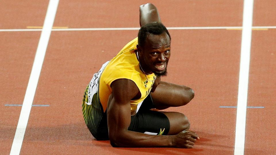Usain Bolt's final race ended in disappointment as he suffered a muscle cramp before the end of the 4x100m relay final which was won by Great Britain.
