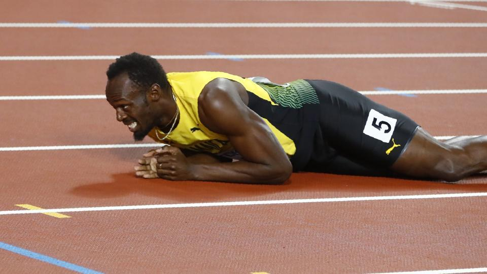 The legendary sprinter fell down on the track due to cramp. (REUTERS)