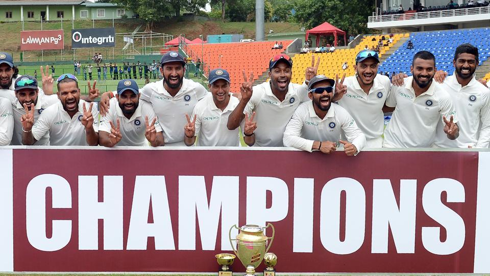 Indian cricketers pose after victory after victory in the third day of the final Test match between Sri Lanka and India at the Pallekele International Cricket Stadium.