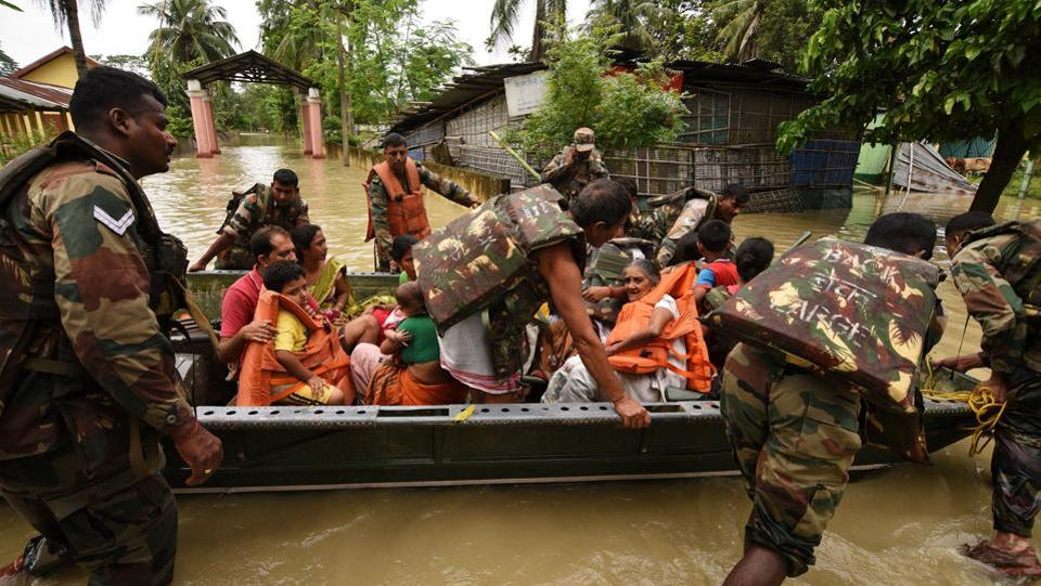 Indian army soldiers evacuate villagers affected by floods in state of Assam. Flood waters have submerged 2,734 villages and more than 1.34 lakh hectare of crop area affected. Erosion and breaches of embankments have been reported in more than 11 districts.  (Anuwar Hazarika/REUTERS)
